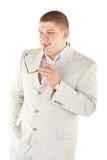 Serious man in a white suit with glasses. Serious man in a white suit. Isolated over white Royalty Free Stock Photo