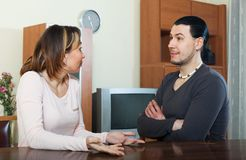 Serious man with wife talking Royalty Free Stock Photos