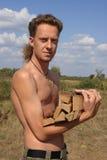 Serious Man With Woodpile Royalty Free Stock Photos