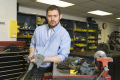 Serious Man In Workshop With Tools Royalty Free Stock Image
