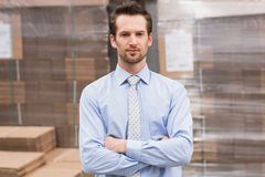 Serious manager with arms crossed in warehouse Stock Photos