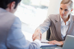 Serious manager interviewing a male applicant Stock Photos