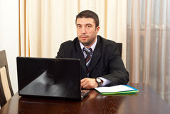 Serious manager with laptop Stock Images