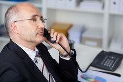 Serious manager at the phone Stock Photos