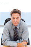 Serious manager sitting at a table Stock Photos