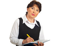 Serious manager woman taking notes Royalty Free Stock Images