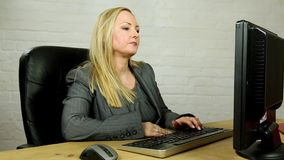 Serious mature blonde doctor lawyer or business woman stock footage
