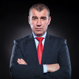 Serious mature business man  with hands folded Stock Images