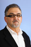 Serious mature businessman with glasses Royalty Free Stock Photography