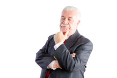 Serious mature businessman thinking on white Stock Images