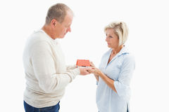 Serious mature couple with model house. On white background Royalty Free Stock Images