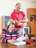 Serious mature couple reading  document Stock Photos