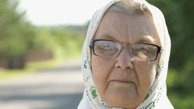 Serious mature elderly woman in glasses. Close-up stock video footage