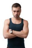 Serious mature man in t-shirt looking at camera on white background. Mature man with serious face looking at camera on white background. Male beauty portrait stock image