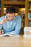 Serious mature student studying at library desk Royalty Free Stock Photography