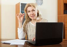 Serious mature woman with documents Royalty Free Stock Photo