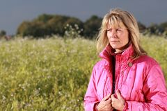 Serious mature woman relaxing in nature Stock Photography