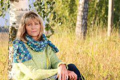 Serious mature woman relaxing in nature Stock Photo