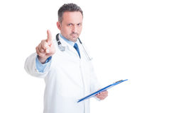 Serious medic or doctor pointing finger at camera Royalty Free Stock Photography