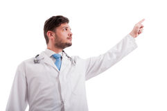 Serious medic or doctor pointing to something up Stock Photo