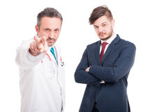 Serious medic or doctor pointing you Stock Photo