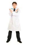 Serious medical doctor with crossed arms isolated Royalty Free Stock Image