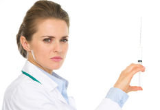 Serious medical doctor woman holding syringe Royalty Free Stock Photos