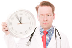 Serious medical time (spinning watch hands version) Royalty Free Stock Photos