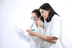 Serious medical workers looking at documentation Stock Photos