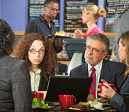 Serious Meeting in Cafe Stock Images