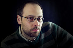 Serious or melancholy look of a man with beard Royalty Free Stock Photography