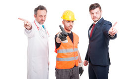 Serious men showing refusal gesture. Serious men with different jobs showing refusal gesture on white studio background Royalty Free Stock Images