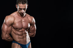 Serious Men Standing And Flexing Muscles Royalty Free Stock Image