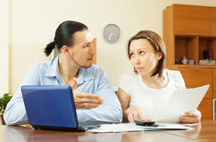 Serious middle-aged couple looking financial document Royalty Free Stock Photo