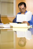 Serious middle-aged Hispanic businessman working Royalty Free Stock Image