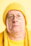 Serious man portrait real people high definition yellow backgrou Royalty Free Stock Images