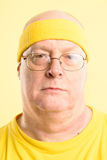 Serious man portrait real people high definition yellow backgrou Stock Photo