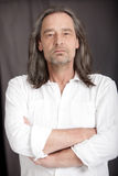 Serious man with shoulder length hair Stock Image