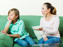 Serious middle-aged mother scolding teenage son Stock Photo