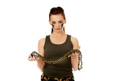 Serious military woman with bullet belt Stock Images