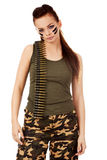 Serious military woman with bullet belt Stock Photo