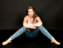 Serious Miserable Young Woman Sitting on Floor Royalty Free Stock Images