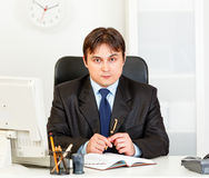 Serious modern business man looking at camera Stock Photography