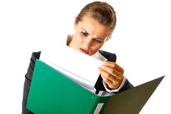 Serious modern business woman exploring documents Stock Photography