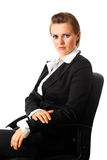 Serious modern business woman sitting on chair Royalty Free Stock Photography