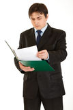Serious modern businessman exploring documents Royalty Free Stock Photos