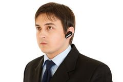 Serious modern businessman with handsfree Stock Photo