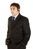 Serious modern businessman with handsfree Stock Photos