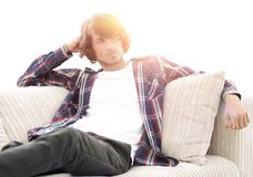 Serious modern guy sitting on the couch. Photo with blank space for text Stock Photo