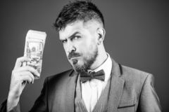 Serious about money. Making money with his own business. Bearded man holding cash money. Rich businessman with us. Dollars banknotes. Currency broker with royalty free stock images